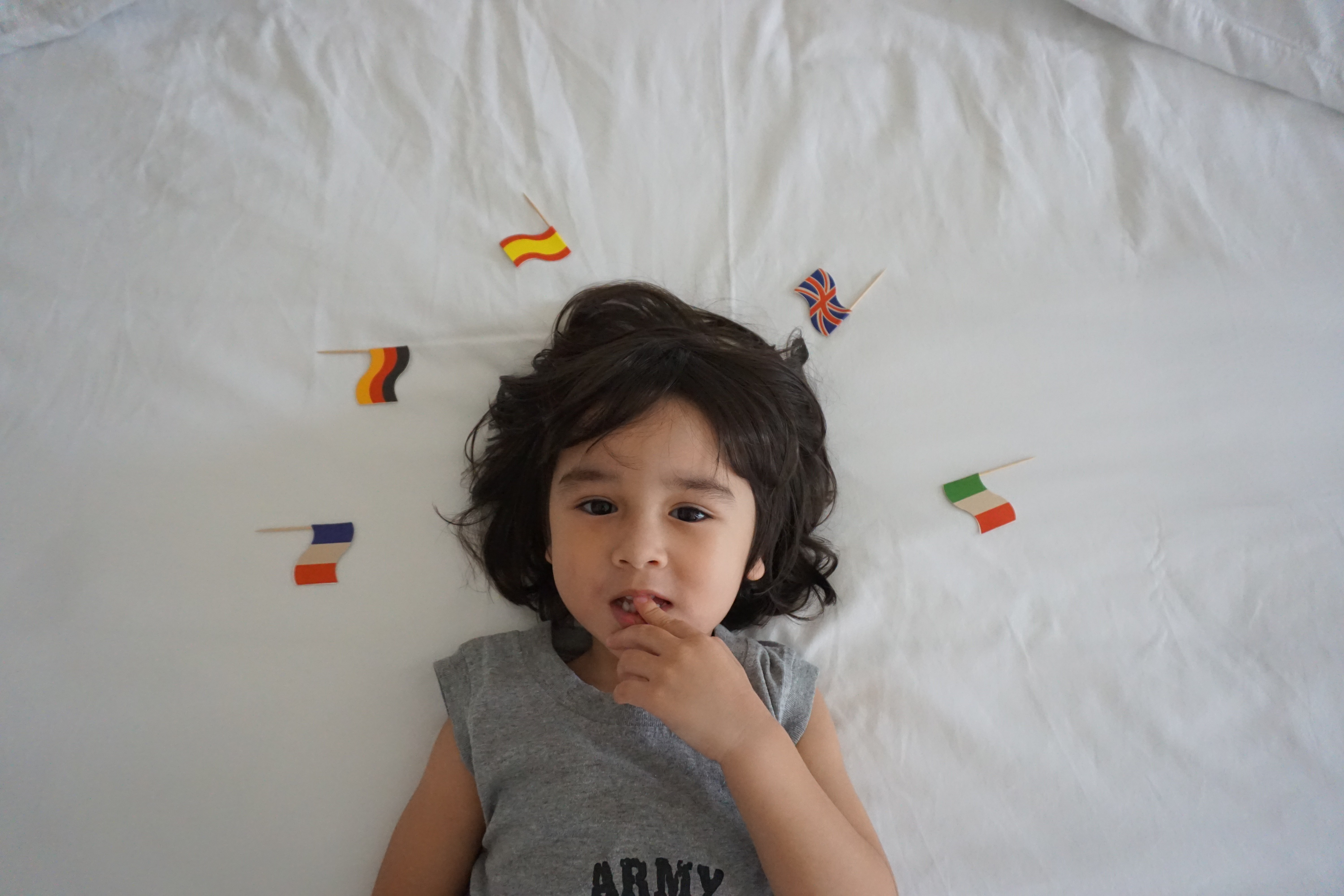 Noah on bed with flags Feb 2017 2